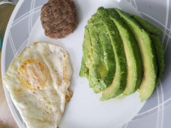 eggs sausage and avocado breakfast