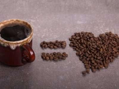 Coffee mug and heart made of coffee beans