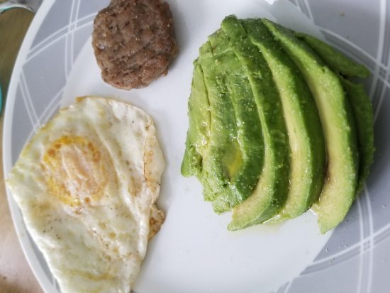 eggs sausage and avocado breakfast