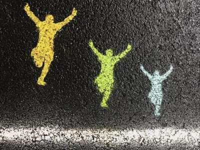 chalk drawing of runners at finish line